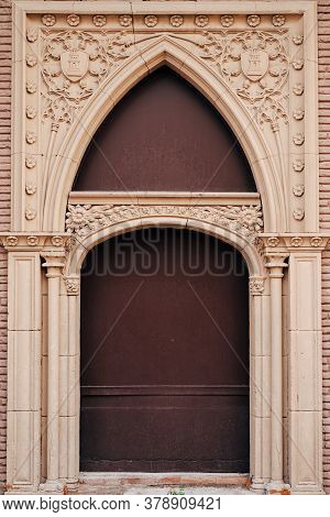Brown Original Doors With Patterns And Columns And Arch And Hand Sculpting