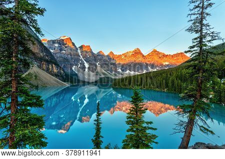 Golden Sunrise Over The Valley Of The Ten Peaks With Glacier-fed Turquoise-colored Moraine Lake In T