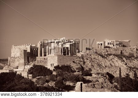 Acropolis historical ruins on top of mountain in Athens, Greece.