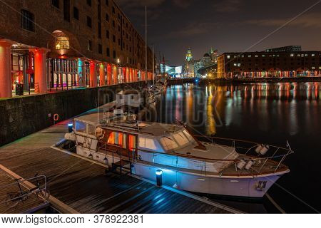 Royal Albert Dock with historical buildings in England, United Kingdom.