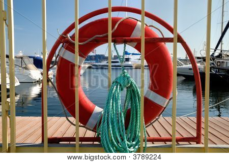 Life Buoy And Cord On A Fence