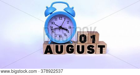 August 1.august 1 On Wooden Cubes On A White Background.blue Watch.photos For The Holiday .the Last