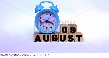 August 9.august 9 On Wooden Cubes On A White Background.blue Watch.photos For The Holiday .the Last