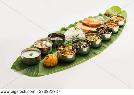 South Indianstyle Lunch Or Dinner Meal Or Food Served With A Selection Of Recipes Over Banana Leaf