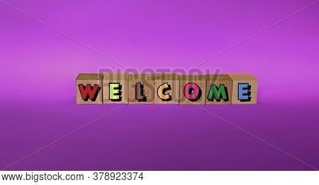 Welcome To The Wooden Cubes With Colorful Letters On A Purple Background.welcome Concept, Business,