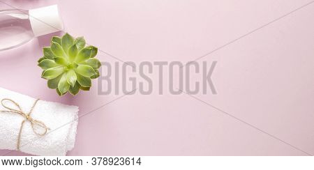 Care Products Lotion, Plant, Towel. Bath Accessories On Pink Background, Top View, Copyspace, Banner