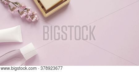 Care Products Tonic, Cream, Plant, Soap. Bath Accessories On Pink Background, Top View, Copyspace. B