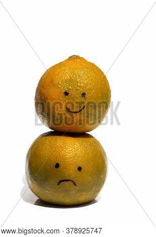Happy Face On Sad Face Drawn On Ripe Oranges Isolated On White Background