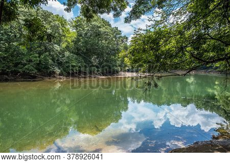 Scenic View Of The Quiet And Calm Slow Moving Current Of The Chattahoochee River In Georgia On A Bri