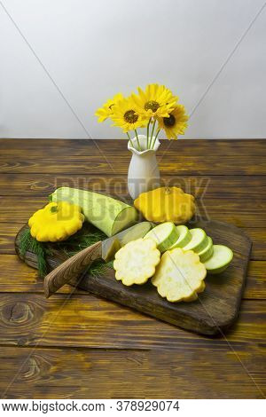 Vegetables Are Cut With A Knife On A Dark Wooden Board. Squash And Squash, Ingredients For A Mono Di