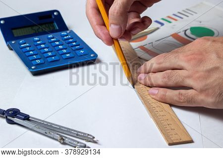 Calculations. Male Hand Draws Lines With A Pencil Along The Ruler. Engineering Calculation. Creation