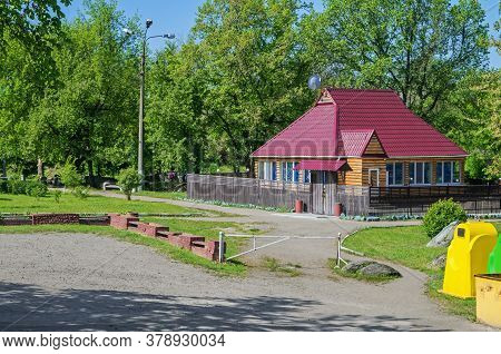 Small Ukrainian-style Farmstead Surrounded By Spring Green Vegetation