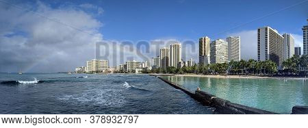 Waikiki - January 8, 2020: People Play In The Protected Water And Hang Out On The Beach With Rainbow