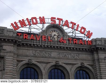 Denver -  July 7, 2015: Union Station Sign Travel By Train Sign And Clock On Top Of Building.