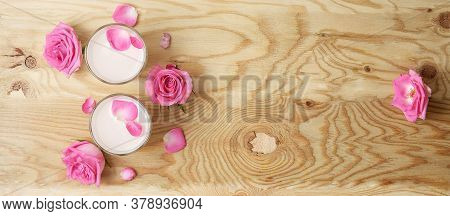 Glasses Of Moon Milk With A Roses On Wooden Table. Ayurvedic Relaxing Drink For The Night.
