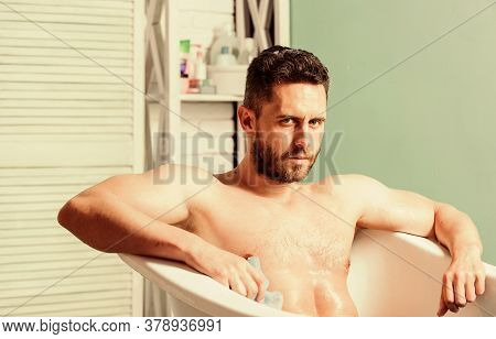 Male Care. Sex And Relaxation Concept. Man Wash Muscular Body With Foam Sponge. Macho Enjoying Bath.