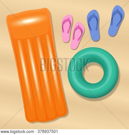 Sand Beach With Sandals Of Love Couple, Air Mattress And Swim Ring. Two Pairs Of Flip Flops On A Bea