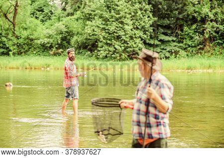 Fisherman With Fishing Rod. Activity And Hobby. Fishing Freshwater Lake Pond River. Bearded Men Catc