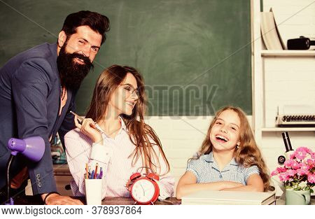 Tutor For Excellence. Extra Classes. Gifted Child. Little Girl Studying With Team Of Tutors. Home Tu