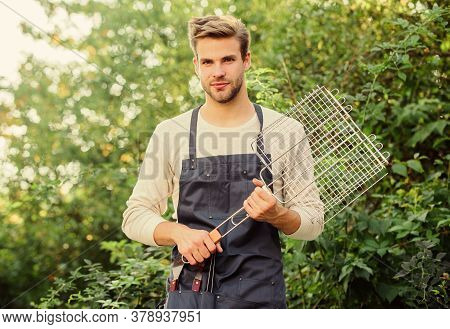 Backyard Barbeque Party. Picnic Concept. Handsome Guy Cooking Food. Healthy Meal. Recipe Grill. Diff