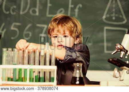 Kid In Lab Coat Learning Chemistry Little Boy At Chemical Cabinet. Chemistry Lab. Back To School. Ex