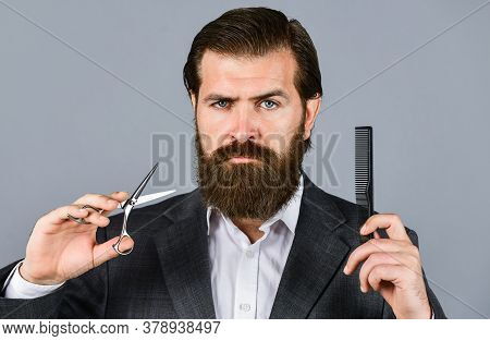 Bearded Man Hold Hair Brush And Scissors. Confident And Handsome Brutal Man. Facial Care. Mature Hip