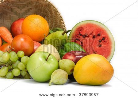 Fruits And Vegetable Spilled Out From A Basket