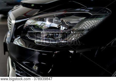 Close-up Image Of Headlights Of Black Premium Car