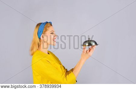 Presentation. Woman In Yellow Jacket With Cloche Food. Retro Woman Holds Metal Tray With Lid. Restau