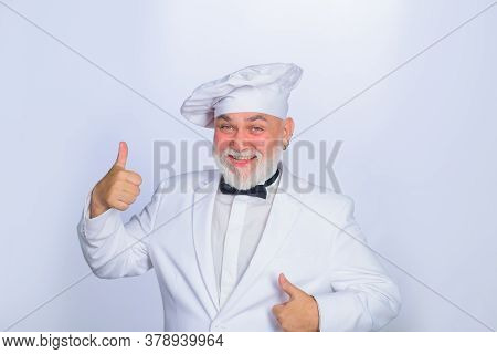 Male Chef In White Uniform Shows Thumb Up. Cooking. Old Bearded Cook With Perfect Sign. Cooking Conc