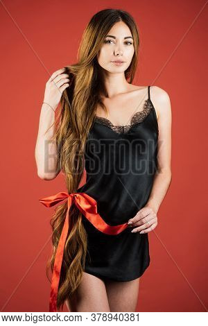 Hair Cosmetics. Beautiful Model With Very Long Hair. Hairdresser, Beauty Salon. Hairstyle And Health