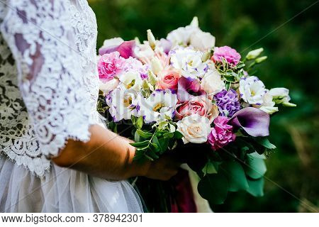 Bridal Bouquet, Hold The Wedding Bouquet In Your Hand, Satin Ribbons Adorn The Wedding Bouquet Of Ro