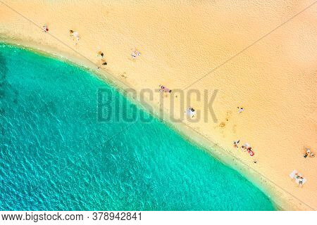 Top View Of The Azure Coast With Beautiful Water And People Resting On The Shore. Yellow Warm Sand A