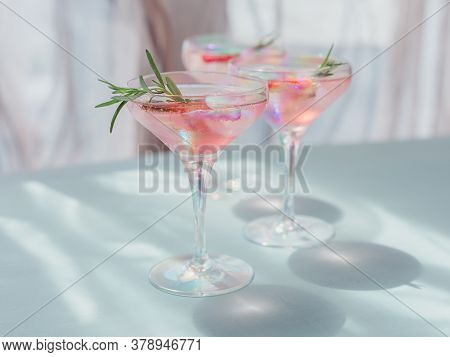 Fresh Strawberry Cocktail. Summer Pink Cocktail With Strawberry, Rosemary And Ice Cubes On Light Blu