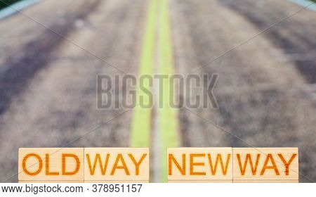 Old Way New Way. Wooden Blocks With The Inscription Old Way New Way On The Background Of Road Stripe