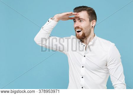 Excited Young Bearded Man Guy 20s In White Classic Shirt Isolated On Pastel Blue Background Studio.