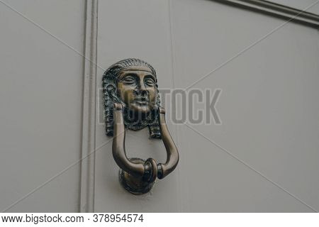 Close Up Of A Sphynx Head Door Knocker On A Door Of A Typical British House.
