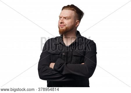 Photo Of Puzzled Bearded Man In Black Jeans Jacket
