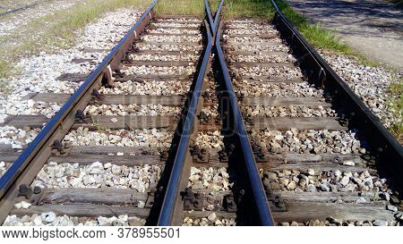 Railways. Rails And Sleepers On The Ground Near The Station. Long Way Concept. Interlacing Of Tracks
