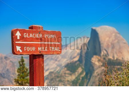 American Sunset: Wooden Road Sign Of Glacier Point Trail In Yosemite National Park, California, Unit