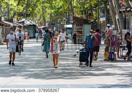 Barcelona, Spain - July 28 2020:  People Walking Through Empty Streets After Covid 19 In Barcelona,