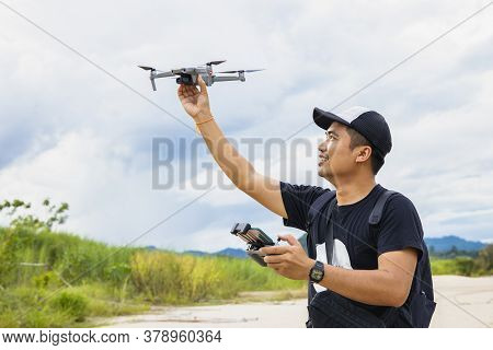 Drone With High Resolution Digital Camera On The River And Sky..