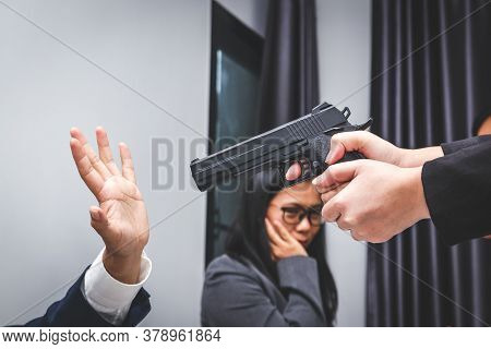 A Group Of Workers Arguing Violently A Woman With A Gun Will Shoot At A Man In The Office.