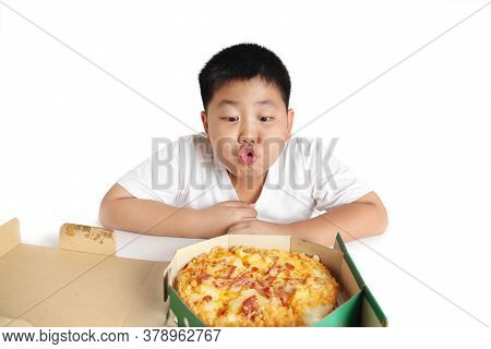Fat Children Sitting To Eat Pizza Is A Wrong Eating Behavior. Children Who Are Overweight Should Not