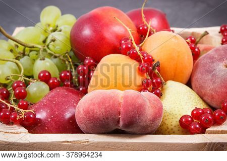 Fresh Natural Fruits In Wooden Box. Nutritious Food Containing Healthy Minerals And Vitamins
