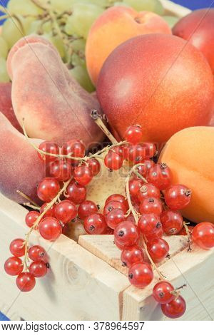 Fresh Ripe Fruits In Wooden Box As Healthy Snack Or Dessert Containing Natural Vitamins And Minerals