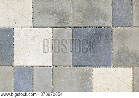 Paving Slabs, Top View. Texture Of Paved Tiles. Stone Floor.