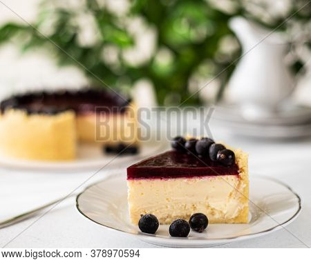 Blackcurrant Cheesecake. Slice Of Berry Cheesecake On A White Plate. Cheesecake With Berries And Ber