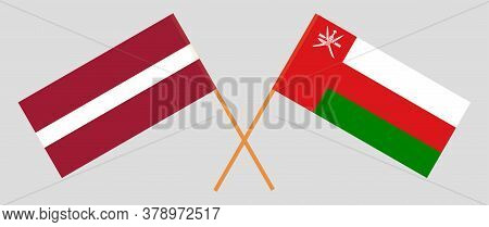 Crossed Flags Of Oman And Latvia. Official Colors. Correct Proportion. Vector Illustration