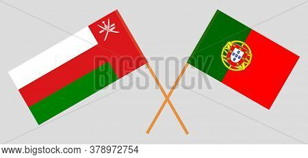 Crossed Flags Of Oman And Portugal. Official Colors. Correct Proportion. Vector Illustration